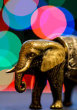Elephant. A small decorative statuette of elephant with color bokeh Royalty Free Stock Images