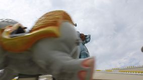 Elephant spinning - amusement park stock video footage