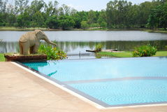 Elephant statuary near swimming pool Stock Photography