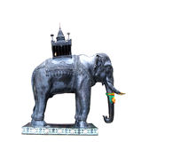 Elephant statue. With a carved wooden howdah Stock Images