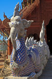 Elephant Statue and Buddhist Temple Stock Photography