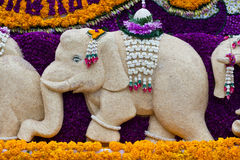 Elephant statue decorated with flowers. Royalty Free Stock Photos