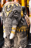 Elephant statue decorated with gold at shrine. Elephant statue decorated with gold at Buddhist shrine in southern Thailand Stock Photo