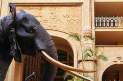 Elephant statue with elephant sculpture over the door. Elephant statue with elephant sculpture over the door at Sun City resort, South Africa stock images
