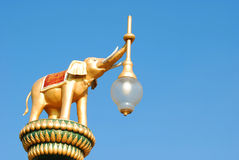 Elephant statue holding a lamp Royalty Free Stock Image