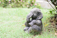 Elephant statue on the lawn Stock Photos