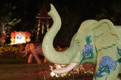Elephant statue at night in garden Stock Image