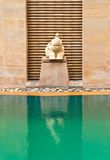 Elephant statue outside of swimming pool. Royalty Free Stock Photography