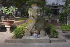 Elephant Statue in Quan Thanh Temple. An elephant statue in the grounds of the historic Quan Thanh Temple in the Ba Dinh district of Hanoi, Vietnam. The temple Stock Photos