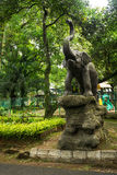 Elephant statue standing on rock in front of children playground photo taken in Ragunan zoo Jakarta Indonesia Stock Photos