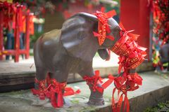 Elephant statue taiwan. Red  tie royalty free stock image