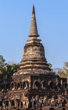 Elephant statues around ancient pagoda. Royalty Free Stock Images
