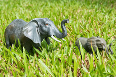 Elephant statues on the grass Royalty Free Stock Images
