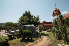 Elephant statues at Wat Chalong Temple. A wide-angle view of elephant statures and shrines at the ornately decorated Wat Chalong,a famous Buddhist Temple in Stock Image