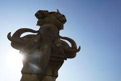 Elephant stone sculpture with lens fare effect stock photography