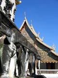Elephant Temple. Concrete elephants and a buddhist temple in Chiang Mai, Thailand Royalty Free Stock Photography