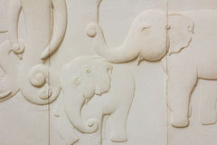 Elephant texture pattern on stone wall in public thai temple. Stock Photos