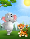 Elephant and tiger cartoon in the jungle Royalty Free Stock Photos