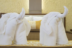 Elephant towel decoration in resort bedroom. Stock Photos