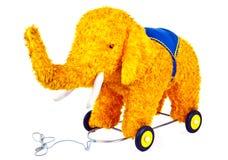 Elephant toy. A yellow fury toy elephant on wheels Royalty Free Stock Photography