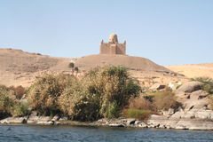 Elephantine Island & Aga Khan Mausoleum. Elephantine is an island in the Nile in northern Nubia. It is a part of the modern city of Aswan, in southern Egypt Royalty Free Stock Photography