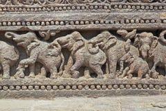 Elephants Adorning Konark Temple. Relief carving of elephants around the base of the ancient Surya Hindu Temple at Konark, Orissa, India. 13th Century AD Stock Photos