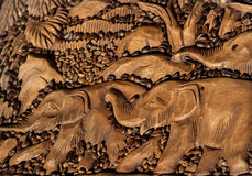 Elephants antique carving on a tree royalty free stock image