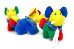 Elephants, Baby Toy. Soft baby toy – elephants in a row, isolated stock photography