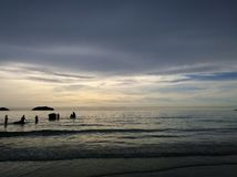 Elephants bathing in the ocean during sunset. Koh Chang island , Thailand. Silhouettes of elephants bathing in the ocean during sunset. Koh Chang island Stock Images