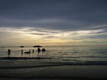Elephants bathing in the ocean during sunset. Koh Chang island , Thailand. Silhouettes of elephants bathing in the ocean during sunset. Koh Chang island Royalty Free Stock Images