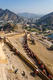Elephants climbing the path to Amber Fort in Jaipur Stock Photography