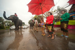 Elephants and peoples dancing in Songkran festival in Thailand. AYUTTAYA, THAILAND - APRIL 15: Songkran Festival is celebrated in a traditional New Year s Day royalty free stock image