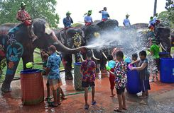 Elephants play water battle with children during Songkran. Festival in Ayutthaya province on April 11, 2018 Stock Images