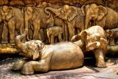 Elephants sculpture composition. Bronze elephants sculpture composition in Nong Nooch Garden (Pattaya, Thailand Royalty Free Stock Image