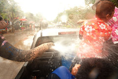 Elephants splashing water in Songkran festival in Thailand. AYUTTAYA, THAILAND - APRIL 15: Songkran Festival is celebrated in a traditional New Year s Day from stock photo