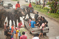 Elephants splashing water in Songkran festival in Thailand. AYUTTAYA, THAILAND - APRIL 15: Songkran Festival is celebrated in a traditional New Year s Day from royalty free stock photos