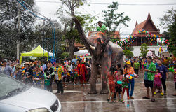 Elephants spray water in celebration of the Songkran water festi. AYUTTHAYA, THAILAND -APRIL 13: Elephants spray tourists with water in celebration of the Royalty Free Stock Images