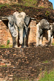 Elephants statues on ruins of Buddhist temple. Royalty Free Stock Images