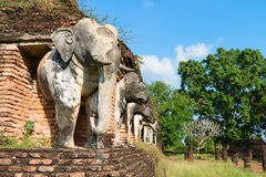Elephants statues on ruins of Buddhist temple. Royalty Free Stock Image