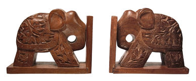 Elephants on the white. Two wooden elephants of a book-holder are on a white Royalty Free Stock Photo