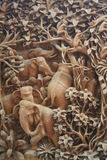 Elephants in the wood - woodcarving. The panel which is cut out from a tree - elephants in the beautiful rainforest Royalty Free Stock Image