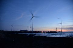 Eletric Power Generator Wind Turbine. Over a Cloudy Sky in Jeju Coast Stock Photography