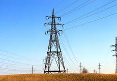 Eletricidade, pilões, poder, linhas Fotografia de Stock Royalty Free