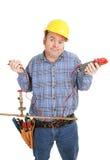 Eletricista confundido por Encanamento Imagens de Stock