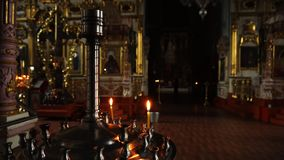 Elets, Russian Federation - April 2, 2018: Orthodox churches. Are the Church candles. Are the Church candles. Close-up video in Orthodox churches stock video footage