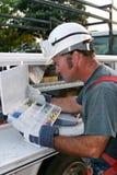 Elettricista con gli strumenti 2 Immagini Stock
