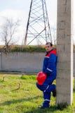 Elettricisti alla sottostazione fotografia stock