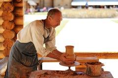 Eletz, Russia - June 13, 2015: Ceramics craftsman making a pot Royalty Free Stock Photography