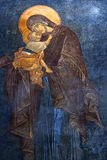 The Eleusa - blessed Virgin Mary and Child. Ancient painted fres Royalty Free Stock Image