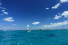 Sailboat Cruising on Clear Water stock photo